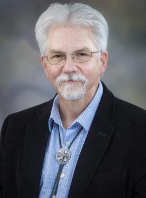 John D. Roache, PhD